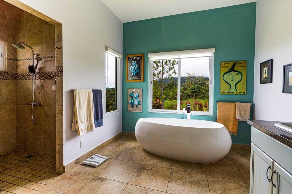a modern bathroom with tile and a bathtub