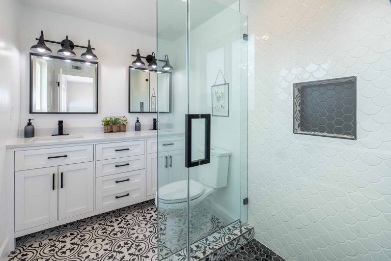 a modern bathroom with a clear shower and high-end features