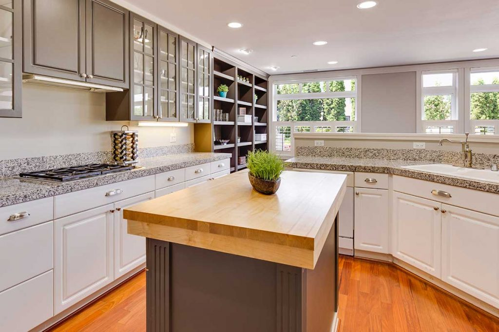 Beautiful white cabinets are displayed in a kitchen